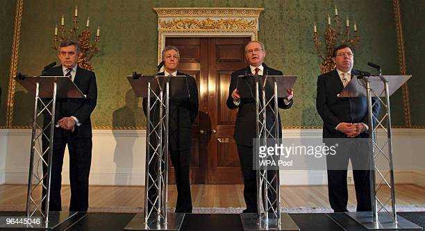 Britain's Prime Minister Gordon Brown Northern Ireland's First Minister and DUP leader Peter Robinson and Ireland's Taoiseach Brian Cowen listen as...