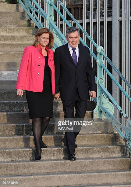 Britain's Prime Minister Gordon Brown takes his wife Sarah for a walk along the seafront in Brighton early this morning before the start of the...