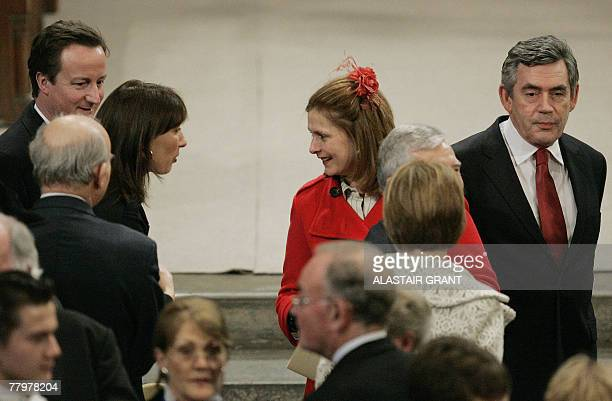 Britain's Prime Minister Gordon Brown walks away as his his wife Sarah talks to Samantha Cameron while Conservative Party Opposition leader David...