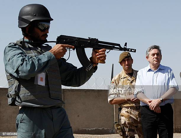 Britain's Prime Minister Gordon Brown watches a display at the Helmand police training centre March 6 2010 in Lashkar Gah southern Afghanistan Brown...