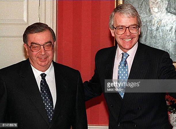 Britain's Prime Minister John Major, right, shows the way to the Russian foreign secretary Yevgeni Primakov before the start of their meeting in...
