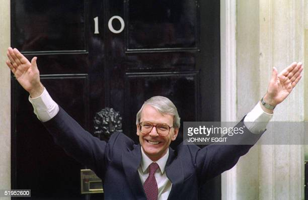 Britain's Prime Minister John Major waves to the crowd outside No 10 Downing Street in London 10 April 1992 after he won a clear majority at the...