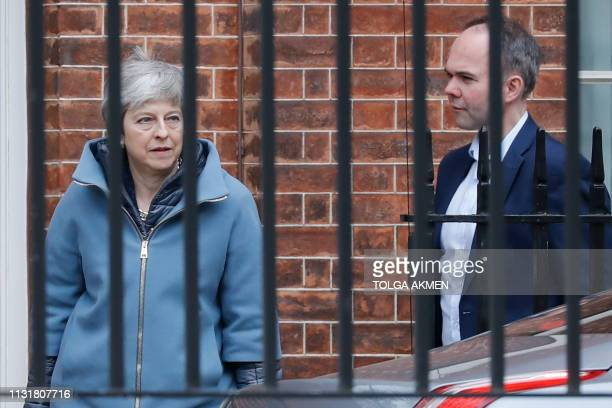 Britain's Prime Minister Theresa May accompanied by Number 10 Chief of Staff Gavin Barwell leaves Downing street on March 21 2019 A dogged but...
