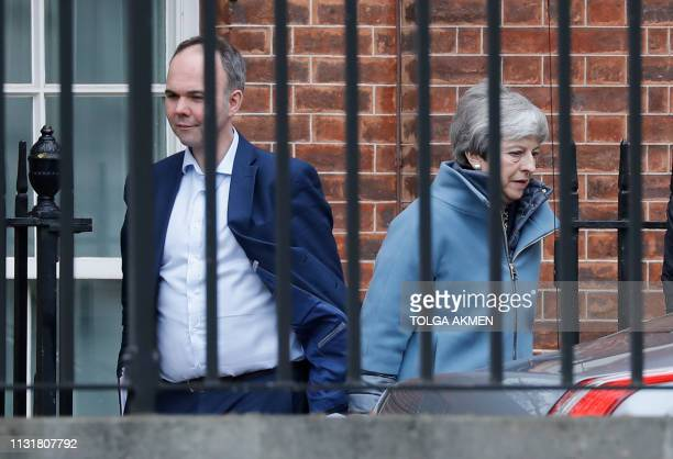Britain's Prime Minister Theresa May accompanied by Number 10 Chief of Staff Gavin Barwell leave Downing street on March 21 2019 A dogged but...