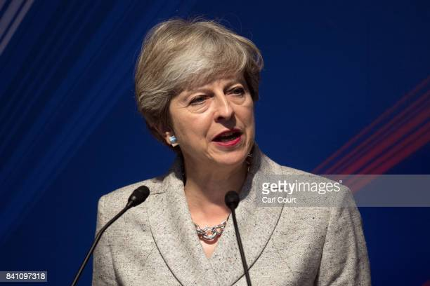 Britain's Prime Minister Theresa May addresses attendees at a JapanUK Business Forum on August 31 2017 in Tokyo Japan Mrs May is on the second day of...