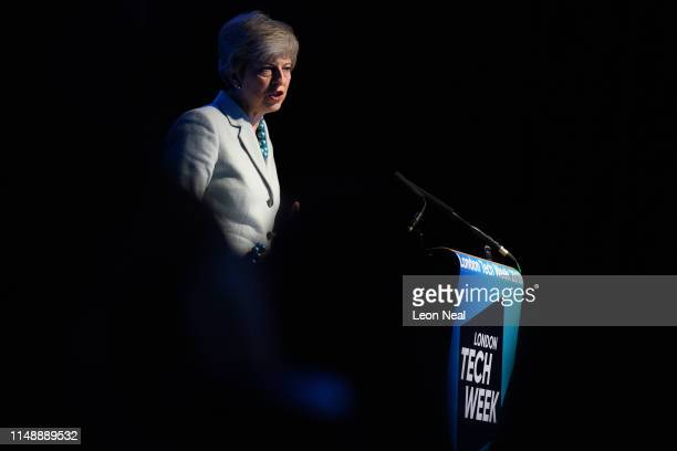 Britain's Prime Minister Theresa May addresses guests during a speech to mark the start of London Tech Week where she announced that global tech...