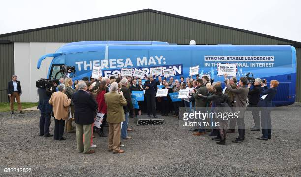 Britain's Prime Minister Theresa May addresses supporters and members of the media in front of the Conservative party's election campaign bus at an...