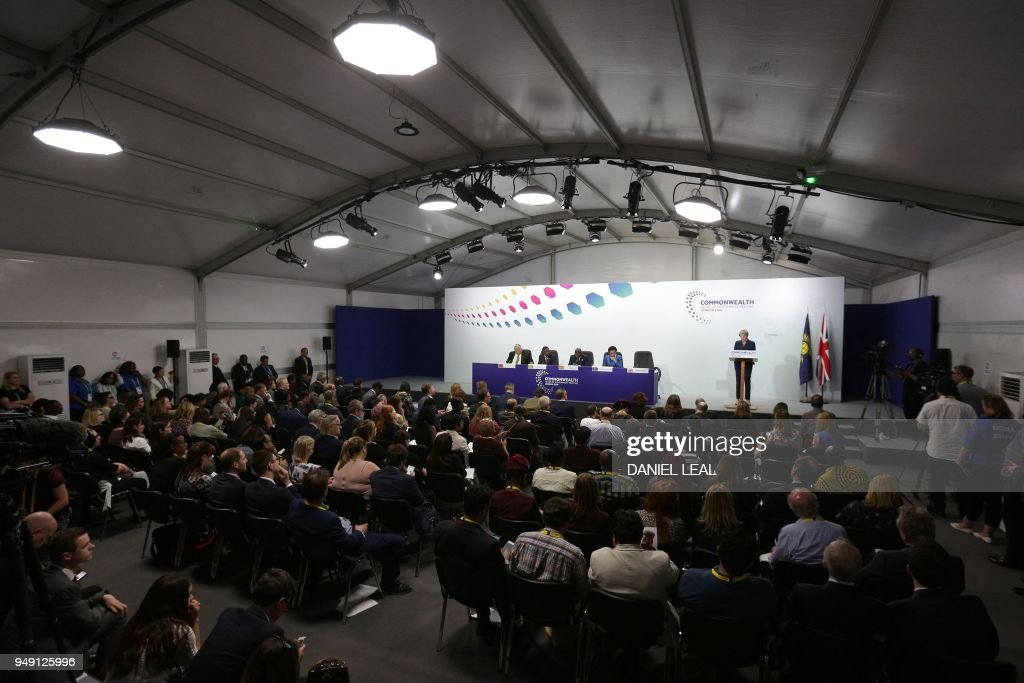 Britain's Prime Minister Theresa May (R) addresses the closing press conference of the Commonwealth Heads of Government Meeting (CHOGM), at Marlborough House in London on April 20, 2018.