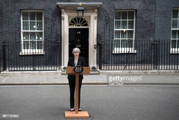 Britain's Prime Minister Theresa May addresses the media as she makes a statement in Downing Street following a COBRA meeting to discuss the...