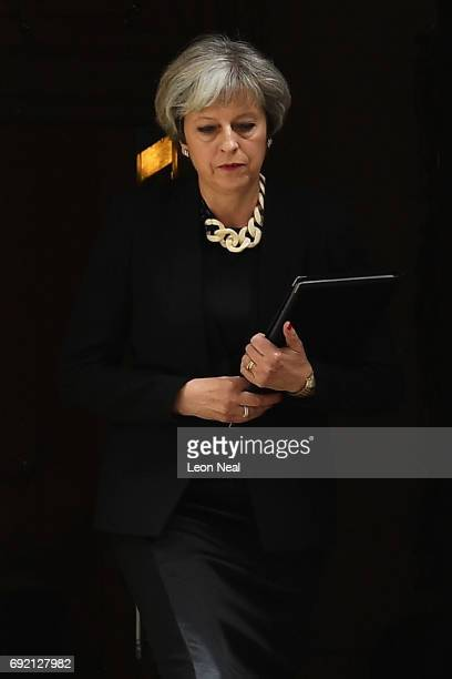 Britain's Prime Minister Theresa May addresses the media as she makes a statement following a COBRA meeting in response to last night's London terror...