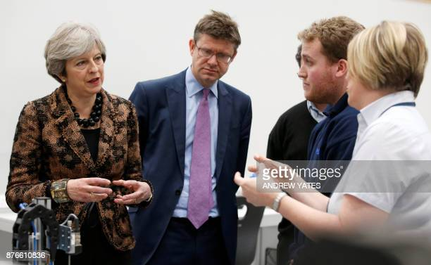 Britain's Prime Minister Theresa May and Britain's Business Energy and Industrial Strategy Secretary Greg Clark visit an engineering training...