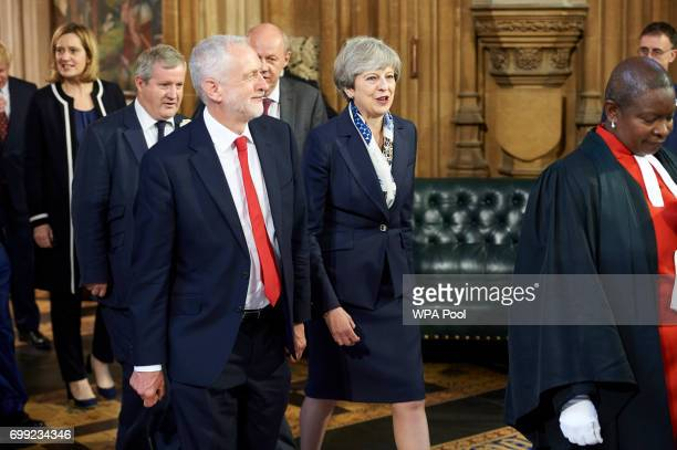 Britain's Prime Minister Theresa May and Britain's main opposition Labour Party leader Jeremy Corbyn walk back across the Central Lobby of the Palace...
