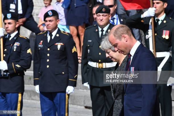 Britain's Prime Minister Theresa May and Britain's Prince William the Duke of Cambridge leave the Cathedral in Amiens after attending a religious...