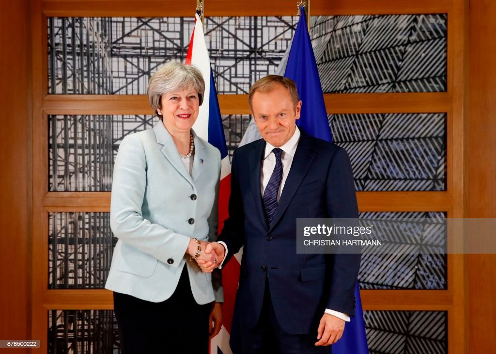 Britain's Prime Minister Theresa May and European Council President Donald Tusk attend a bilateral meeting during the Eastern Partnership summit at the European Council headquarters in Brussels, on November 24, 2017. /