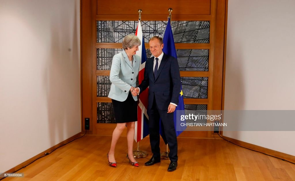 Britain's Prime Minister Theresa May and European Council President Donald Tusk pose for photographers within a bilateral meeting during the Eastern Partnership summit at the European Council headquarters in Brussels, on November 24, 2017. /