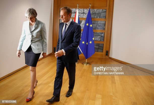 Britain's Prime Minister Theresa May and European Council President Donald Tusk leave after posing for photographers within a bilateral meeting...