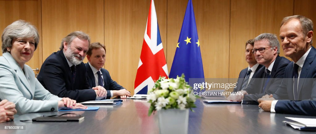 Britain's Prime Minister Theresa May (L) and European Council President Donald Tusk (R) attend a bilateral meeting during the Eastern Partnership summit at the European Council headquarters in Brussels, on November 24, 2017. /