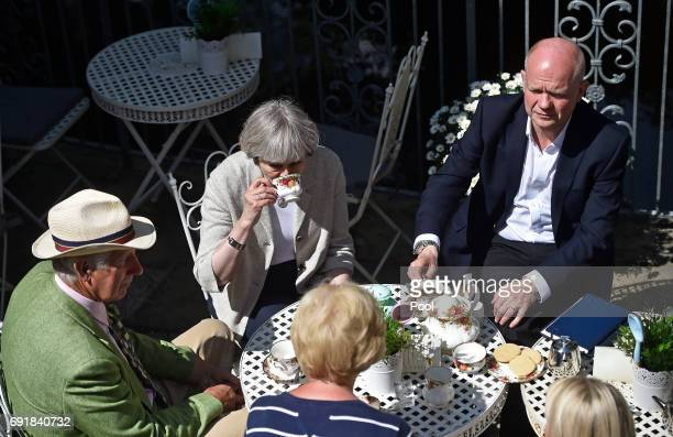 Britain's Prime Minister Theresa May and former Foreign Secretary William Hague drink tea during an election campaign visit to Horsfields Nursery on...