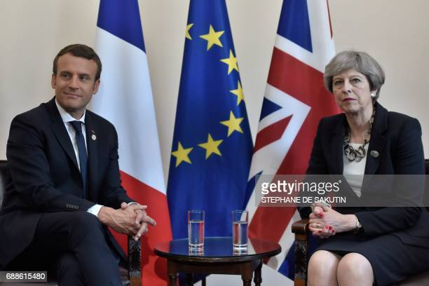 Britain's Prime Minister Theresa May and French President Emmanuel Macron talk during a bilateral meeting at the Summit of the Heads of State and of...