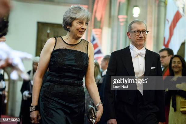 Britain's Prime Minister Theresa May and her husband Philip attend the annual Lord Mayor's banquet on November 13 2017 in London England The Prime...