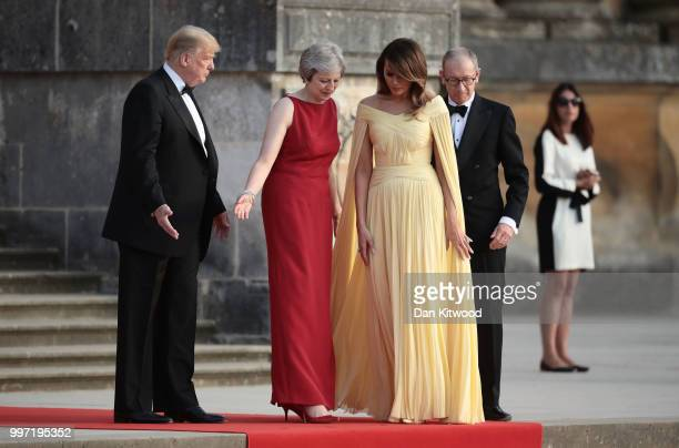 Britain's Prime Minister Theresa May and her husband Philip May greet US President Donald Trump First Lady Melania Trump at Blenheim Palace on July...