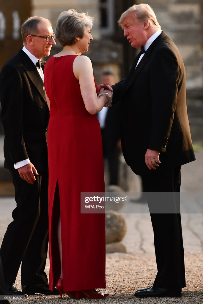 Britain's Prime Minister Theresa May and her husband Philip May greet U.S. President Donald Trump at Blenheim Palace on July 12, 2018 in Woodstock, England. Blenheim Palace is the birth place of the great wartime British Prime Minister, Winston Churchill, of whom the President is a big fan. The Prime Minister hosted dinner for the President and First Lady and business leaders as part of the First Couple's official visit to the UK.