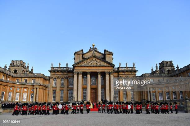 Britain's Prime Minister Theresa May and her husband Philip May greet U.S. President Donald Trump, First Lady Melania Trump at Blenheim Palace on...
