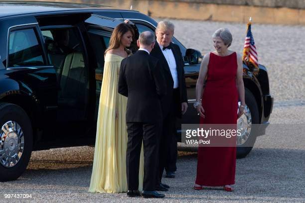 Britain's Prime Minister Theresa May and her husband Philip May greet US President Donald Trump and First Lady Melania Trump at Blenheim Palace on...
