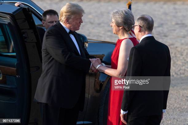 Britain's Prime Minister Theresa May and her husband Philip May greet US President Donald Trump at Blenheim Palace on July 12 2018 in Woodstock...