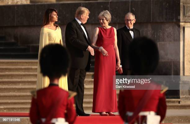 Britain's Prime Minister Theresa May and her husband Philip May stand with US President Donald Trump First Lady Melania Trump on the steps in the...