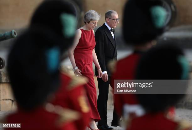 Britain's Prime Minister Theresa May and her husband Philip May wait for the arrival of US President Donald Trump and First Lady Melania Trump at...