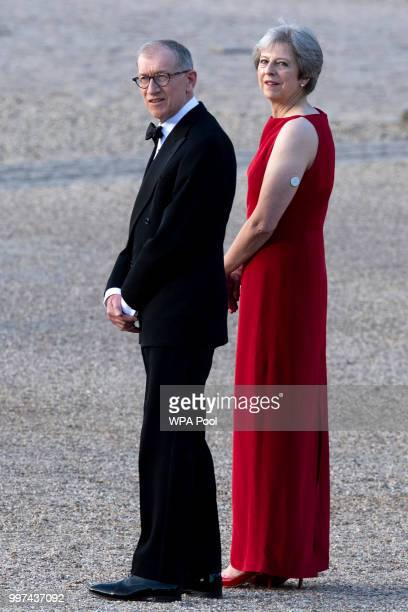Britain's Prime Minister Theresa May and her husband Philip May wait to greet US President Donald Trump and First Lady Melania Trump at Blenheim...