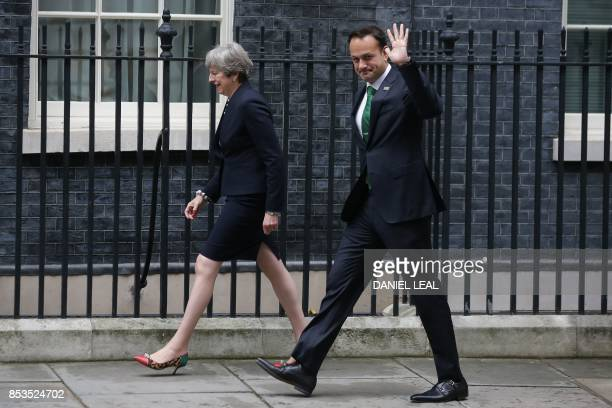 Britain's Prime Minister Theresa May and Ireland's Prime Minister Leo Varadkar walks up Downing Street in central London on September 25 2017 / AFP...