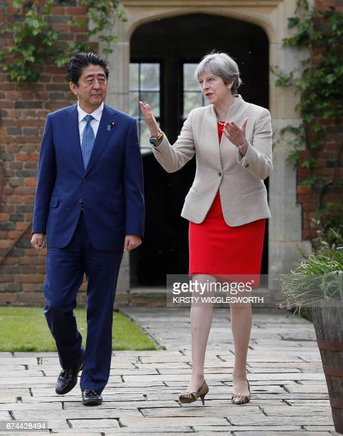 Britain's Prime Minister Theresa May and Japan's Prime Minister Shinzo Abe walk together in the garden at Chequers the prime minister's official...