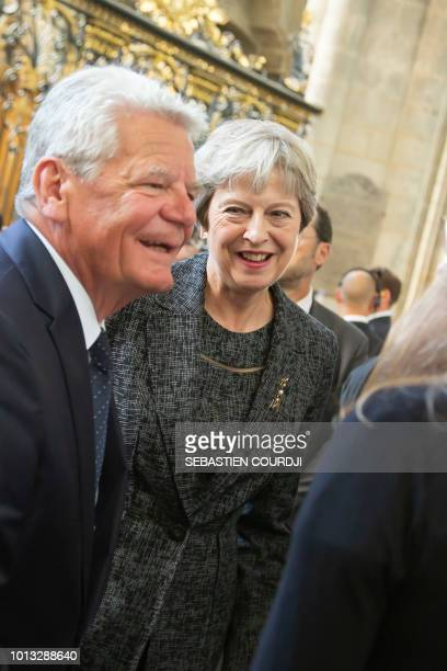 Britain's prime minister Theresa May and Joachim Gauck former German president attend a religious ceremony to mark the 100th anniversary of the World...
