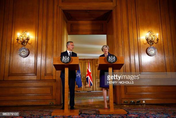 Britain's Prime Minister Theresa May and NATO Secretary General Jens Stoltenberg take part in a joint press conference at 10 Downing Street in London...