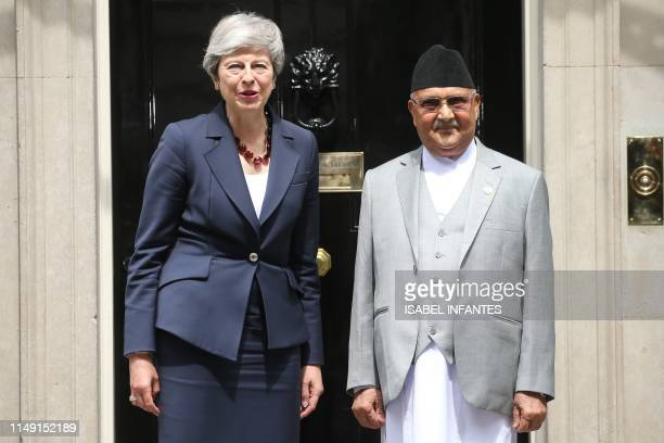 Britain's Prime Minister Theresa May and Nepal's Prime Minister K P Sharma Oli p0se at 10 Downing Street in London on June 11, 2019.