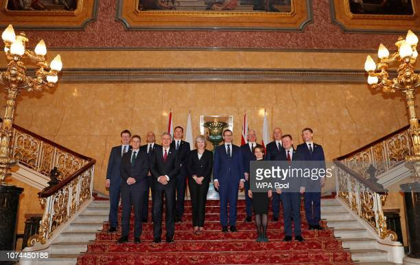 Britain's Prime Minister Theresa May and Poland's Prime Minister Mateusz Morawiecki pose with members of their respective cabinets including...