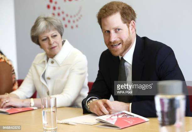 Britain's Prime Minister Theresa May and Prince Harry attend a Commonwealth Heads of Government Meeting Youth Forum on April 16 2018 in London...