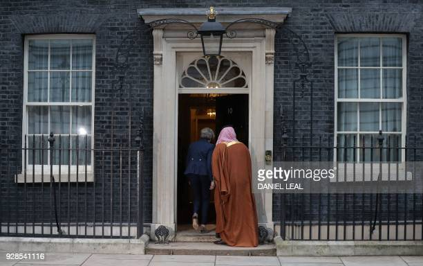 Britain's Prime Minister Theresa May and Saudi Arabia's Crown Prince Mohammed bin Salman go inside 10 Downing Street in central London on March 7...