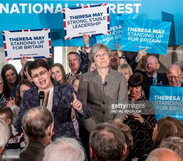 Britain's Prime Minister Theresa May and Scottish Conservative leader Ruth Davidson speak to supporters in the village of Banchory in Aberdeenshire...