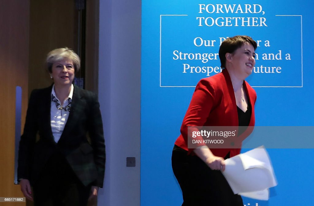 Britain's Prime Minister Theresa May (L) and Scottish Conservative leader Ruth Davidson arrive at the launch of their Scottish manifesto in Edinburgh on May 19, 2017. / AFP PHOTO / POOL / Dan Kitwood