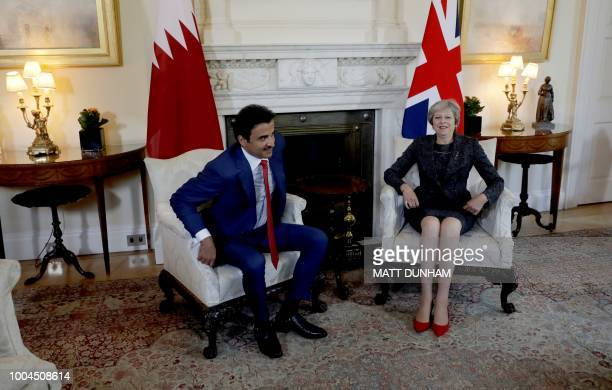 Britain's Prime Minister Theresa May and the Emir of Qatar Sheikh Tamim Bin Hamad alThani take their seats at the start of their meeting inside 10...