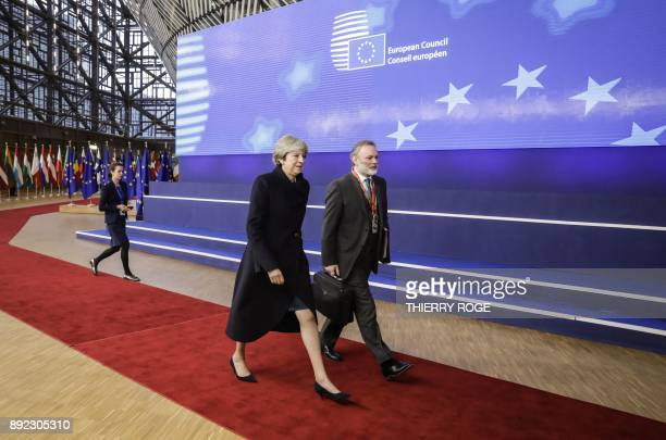 TOPSHOT Britain's Prime minister Theresa May and UK Permanent Representative to the EU Tim Barrow arrive to attend the first day of a European union...