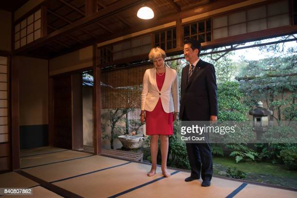 Britain's Prime Minister Theresa May arrives at a Shinto temple to take part in a tea ceremony with Japan's Prime Minister Shinzo Abe on August 30...