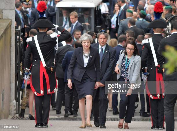 Britain's Prime Minister Theresa May arrives at the ancient Greek Theater during the Summit of the Heads of State and of Government of the G7 the...