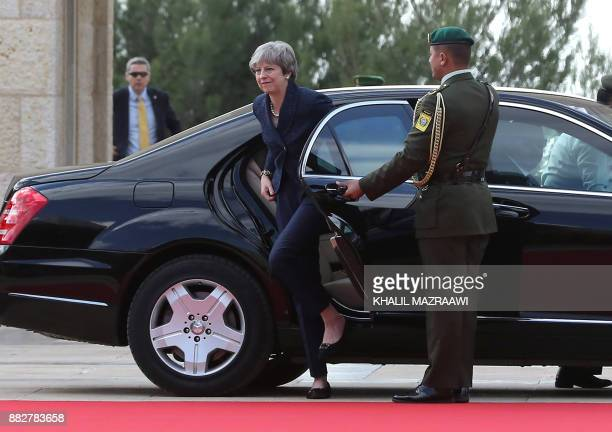 Britain's Prime Minister Theresa May arrives at the royal palace in Amman on November 2017 May has implored Saudi leaders to ease a blockade on...