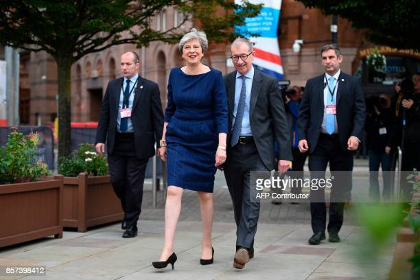 Britain's Prime Minister Theresa May arrives at the venue ahead of her leader's speech with her husband Philip May on the final day of the...