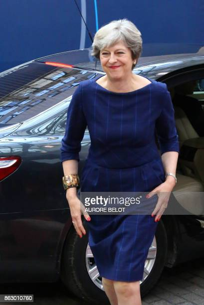 Britain's Prime minister Theresa May arrives in Brussels on October 19 2017 on the first day of a summit of European Union leaders set to rule out...