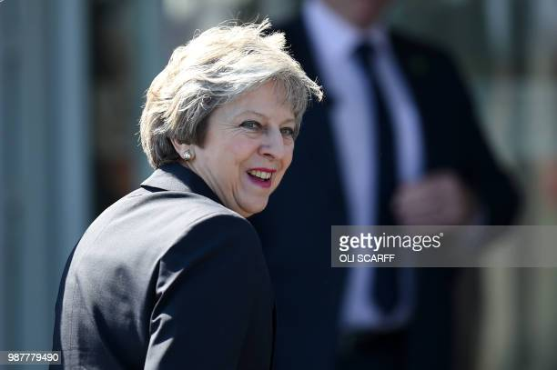 Britain's Prime Minister Theresa May arrives to attend the national Armed Forces Day celebrations at Llandudno north Wales on June 30 2018 The annual...
